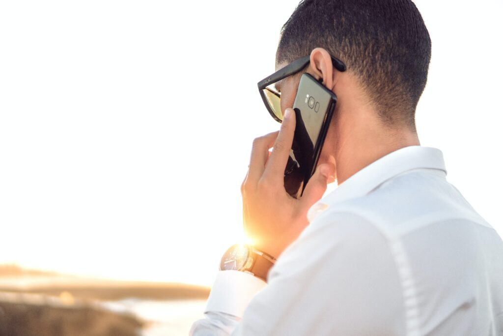 man on phone for phone interview